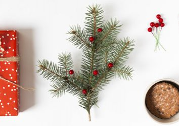 gift-box-with-fir-tree-branch-and-candy-canes_23-2147992532